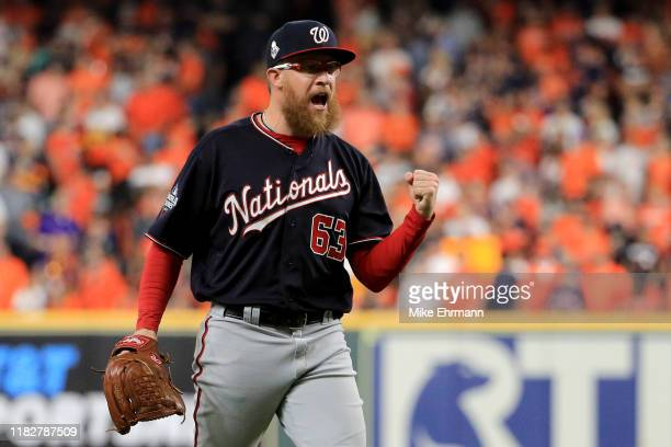 Sean Doolittle of the Washington Nationals celebrates after closing out the teams 5-4 win over the Houston Astros in Game One of the 2019 World...