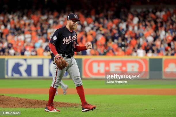 Sean Doolittle of the Washington Nationals celebrates his teams 72 against the Houston Astros in Game Six of the 2019 World Series at Minute Maid...