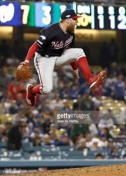 Sean Doolittle of the Washington Nationals celebrates the final out as the Nationals defeated the Los Angeles Dodgers 73 in game five to win the...
