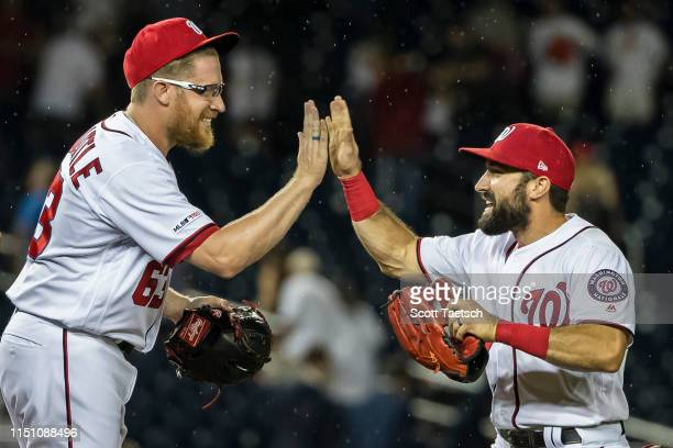 Sean Doolittle of the Washington Nationals celebrates with Anthony Rendon after the game against the Philadelphia Phillies at Nationals Park on June...
