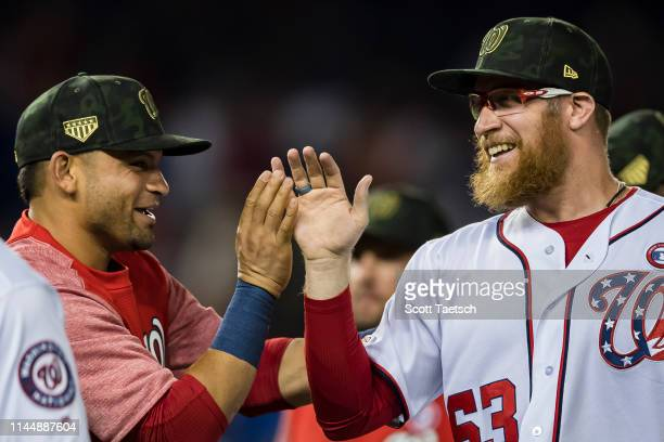 Sean Doolittle of the Washington Nationals celebrates with Gerardo Parra after the game against the Chicago Cubs at Nationals Park on May 18 2019 in...