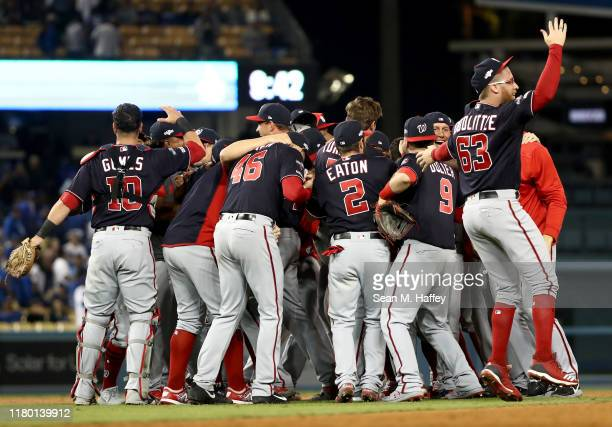 Sean Doolittle of the Washington Nationals celebrates with his team as the Nationals defeated the Los Angeles Dodgers 73 in game five to win the...