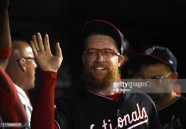 Sean Doolittle of the Washington Nationals celebrates with teammates after being pulled in the ninth inning of game four of the National League...
