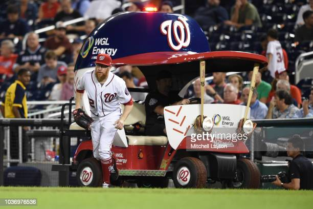 Sean Doolittle of the Washington Nationals comes in the from the bullpen cart when comes in game in the ninth inning during a baseball game against...