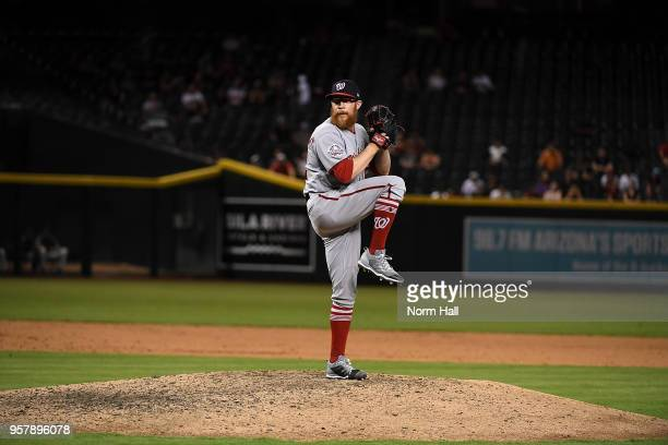 Sean Doolittle of the Washington Nationals delivers a pitch during the eleventh inning against the Arizona Diamondbacks at Chase Field on May 10 2018...