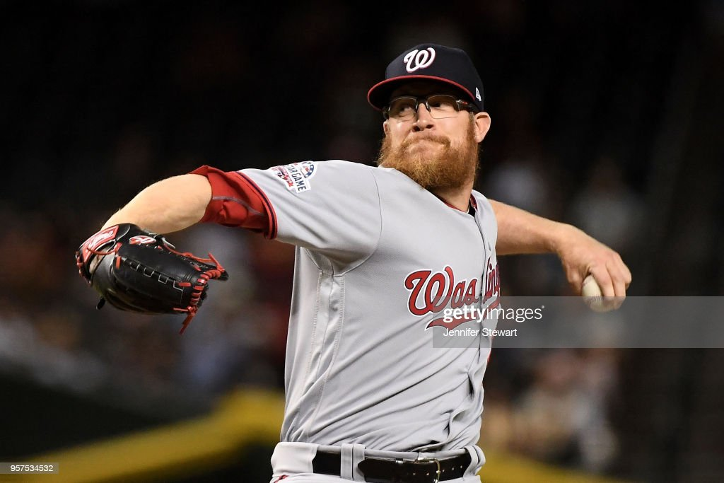 Sean Doolittle #62 of the Washington Nationals delivers a pitch in the ninth inning of the MLB game against the Arizona Diamondbacks at Chase Field on May 11, 2018 in Phoenix, Arizona.