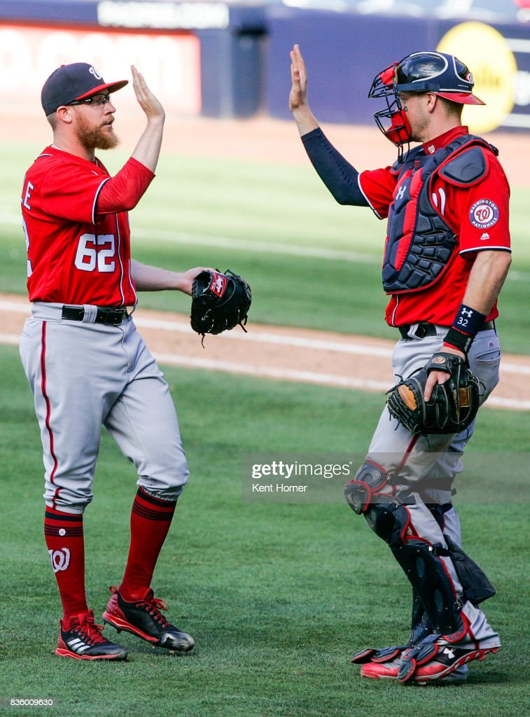 Sean Doolittle #62 of the Washington Nationals is congratulated by catcher Matt Wieters #32 after recording a save against the San Diego Padres at PETCO Park on August 20, 2017 in San Diego, California.