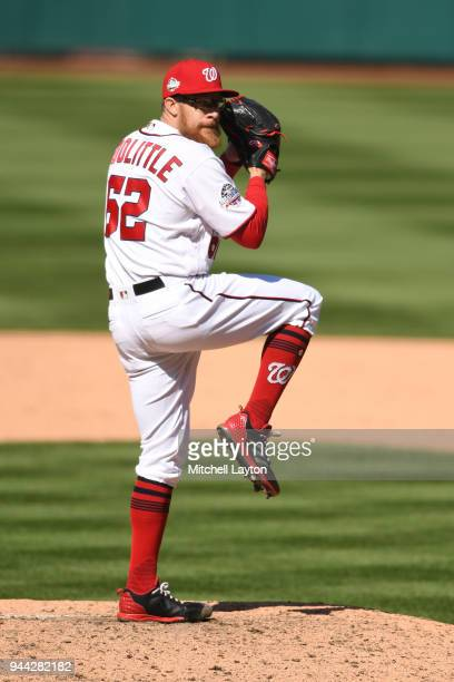 Sean Doolittle of the Washington Nationals pitches during a baseball game against the New York Mets at Nationals Park on April 5 2018 in Washington...