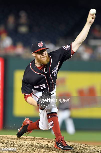 Sean Doolittle of the Washington Nationals pitches in the ninth inning against the Los Angeles Dodgers at Nationals Park on September 17 2017 in...