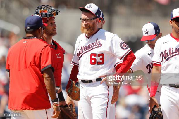Sean Doolittle of the Washington Nationals reacts after being taken out of the game by manager Dave Martinez against the New York Yankees during a...
