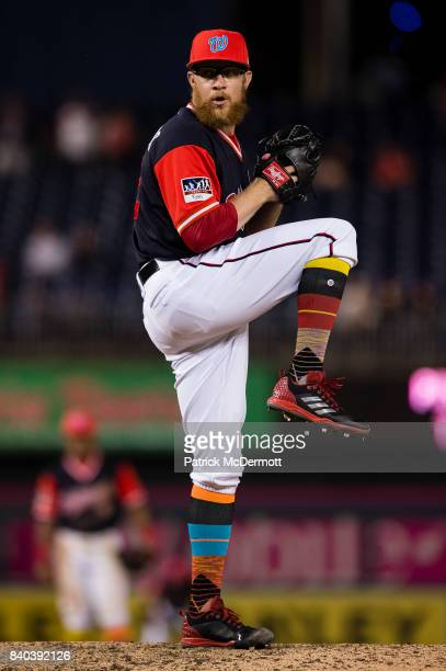 Sean Doolittle of the Washington Nationals throws a pitch to a New York Mets batter in the ninth inning during Game Two of a doubleheader at...