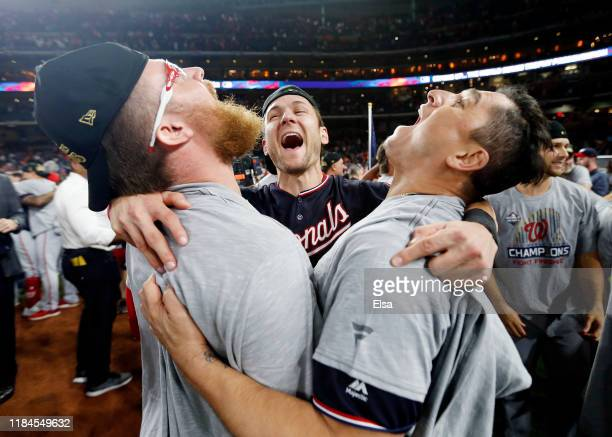 Sean Doolittle Trea Turner and Ryan Zimmerman of the Washington Nationals celebrate after defeating the Houston Astros 62 in Game Seven to win the...