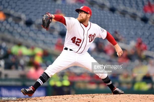 Sean Doolttile of the Washington Nationals pitches during a baseball game against the Colorado Rockies at Nationals Park on April 15 2018 in...