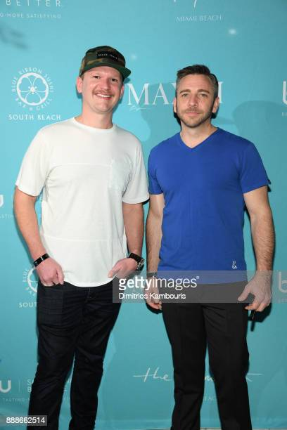 Sean Driscoll and Nick Larkins attend the Maxim December Miami Issue Party Presented by blu on December 8 2017 in Miami Beach Florida