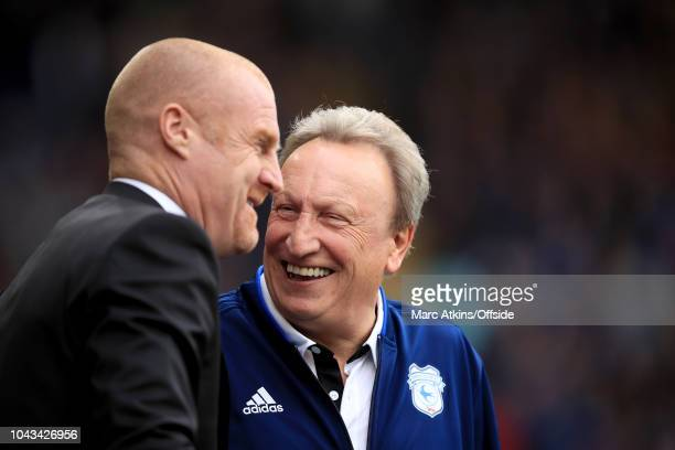 Sean Dyche manager of Burnley alongside Cardiff City manager Neil Warnock during the Premier League match between Cardiff City and Burnley FC at...