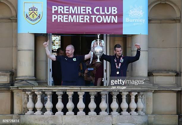 Sean Dyche manager of Burnley and captain Tom Heaton celebrate with the trophy as Sky Bet Champions Burnley are presented with the Championship...