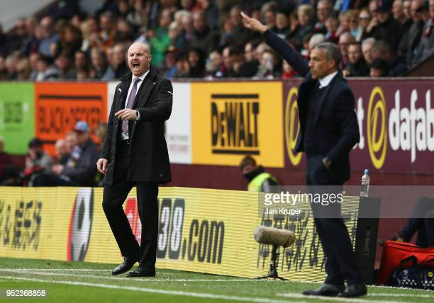 Sean Dyche Manager of Burnley and Chris Hughton Manager of Brighton and Hove Albion give instructions during the Premier League match between Burnley...