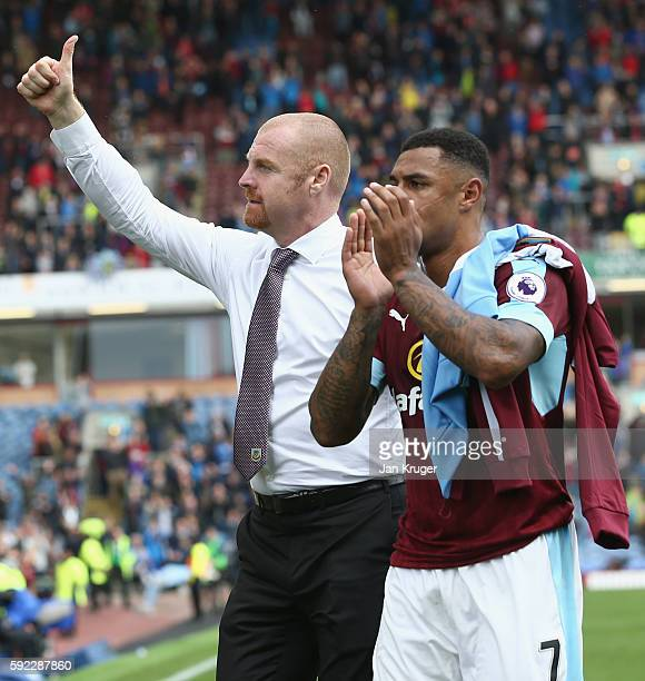 Sean Dyche Manager of Burnley and David Meyler of Hull City claps the home fans after the game during the Premier League match between Burnley and...