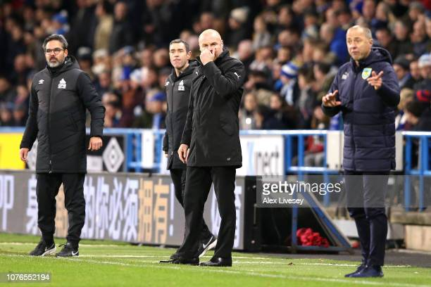 Sean Dyche Manager of Burnley and David Wagner Manager of Huddersfield Town stand on the touchline during the Premier League match between...