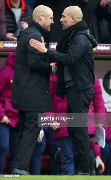 Sean Dyche Manager of Burnley and Josep Guardiola Manager of Manchester City shake hands following the Premier League match between Burnley and...