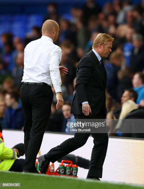 Sean Dyche Manager of Burnley and Ronald Koeman Manager of Everton walk out after the Premier League match between Everton and Burnley at Goodison...