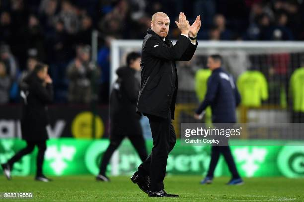 Sean Dyche, Manager of Burnley applauds supporters following victory during the Premier League match between Burnley and Newcastle United at Turf...