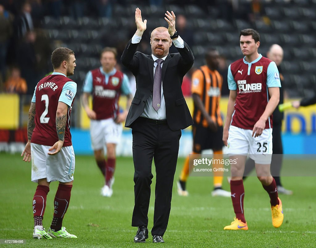 Sean Dyche, manager of Burnley applauds the fans after his team were relegated after the Barclays Premier League match between Hull City and Burnley at KC Stadium on May 9, 2015 in Hull, England.
