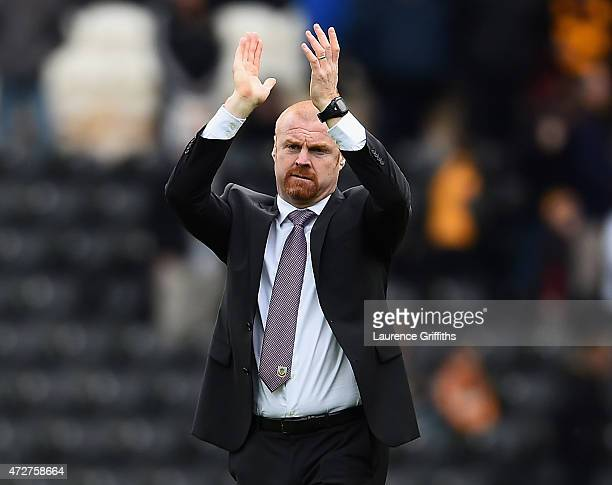 Sean Dyche, manager of Burnley applauds the fans after his team were relegated after the Barclays Premier League match between Hull City and Burnley...