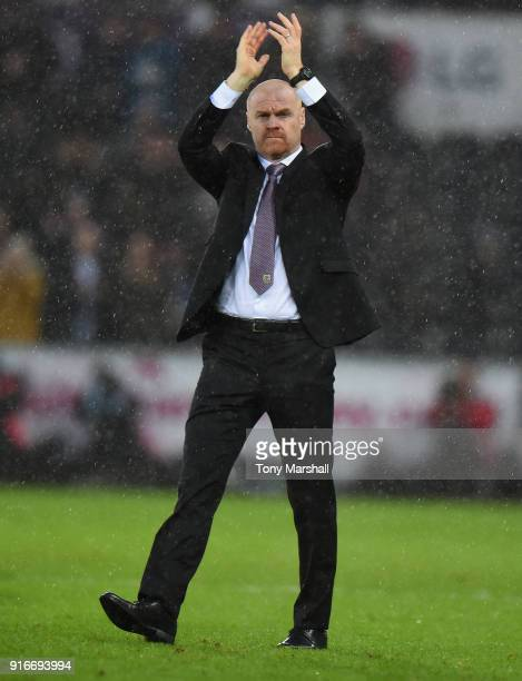 Sean Dyche Manager of Burnley applauds the fans at the end of the Premier League match between Swansea City and Burnley at Liberty Stadium on...