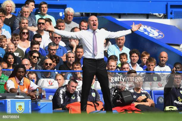 Sean Dyche manager of Burnley gestures during the Premier League match between Chelsea and Burnley at Stamford Bridge on August 12 2017 in London...