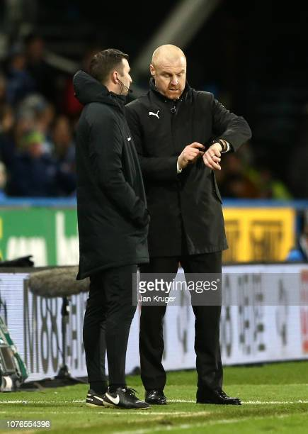 Sean Dyche, Manager of Burnley gestures towards his watch during the Premier League match between Huddersfield Town and Burnley FC at John Smith's...