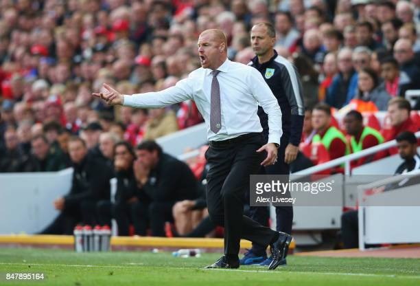 Sean Dyche, Manager of Burnley gives his team instructions during the Premier League match between Liverpool and Burnley at Anfield on September 16,...