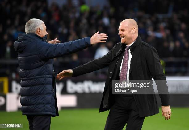 Sean Dyche Manager of Burnley greets Jose Mourinho Manager of Tottenham Hotspur during the Premier League match between Burnley FC and Tottenham...