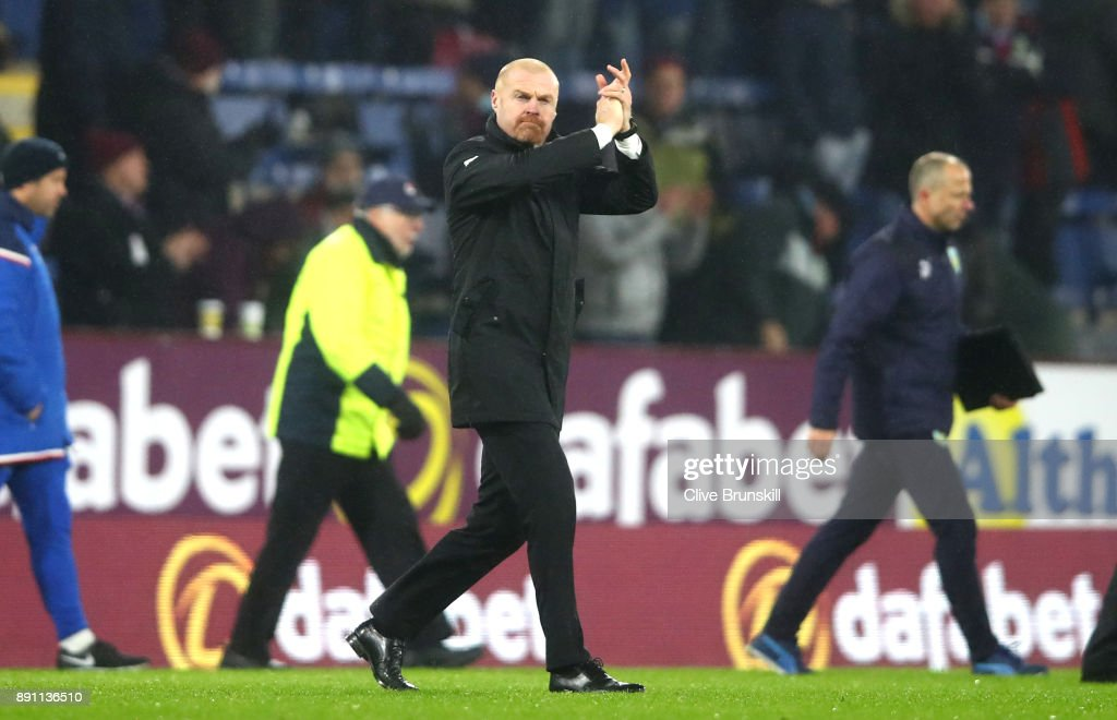 Sean Dyche, Manager of Burnley shows appreciation to the fans after the Premier League match between Burnley and Stoke City at Turf Moor on December 12, 2017 in Burnley, England.