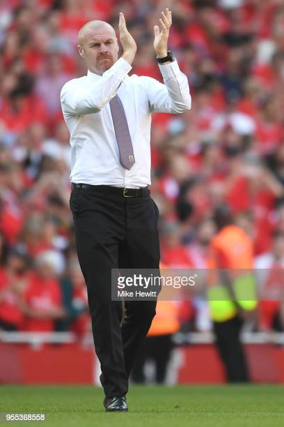 Sean Dyche Manager of Burnley shows appreciation to the fans after the Premier League match between Arsenal and Burnley at Emirates Stadium on May 6...