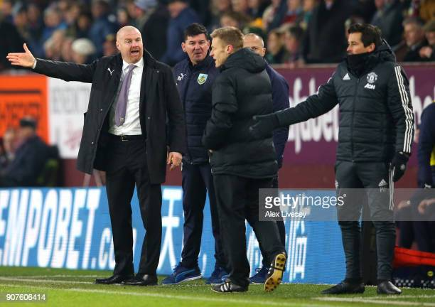 Sean Dyche Manager of Burnley speaks with Fourth Official Mike Jones during the Premier League match between Burnley and Manchester United at Turf...