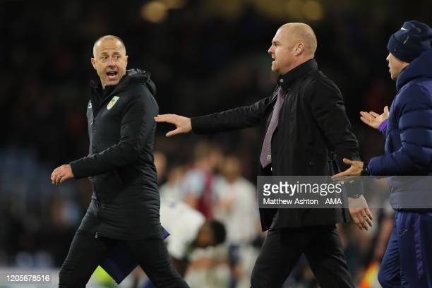 Sean Dyche the head coach / manager of Burnley stops Assistant Manager Ian Woan from arguing with Tottenham Hotspur coaching staff at the end of the...