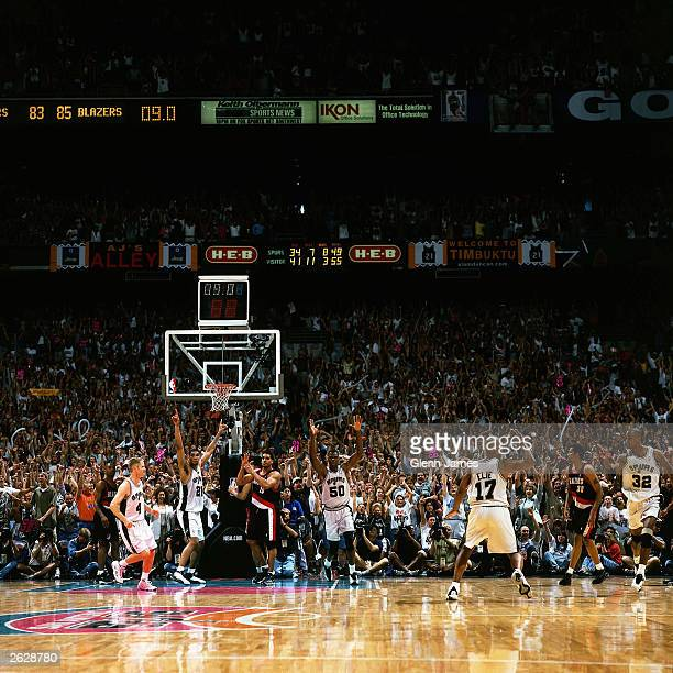Sean Elliott of the San Antonio Spurs celebrates after hitting the gamewinning shot against the Portland Trail Blazers during Game 2 of the 1999...