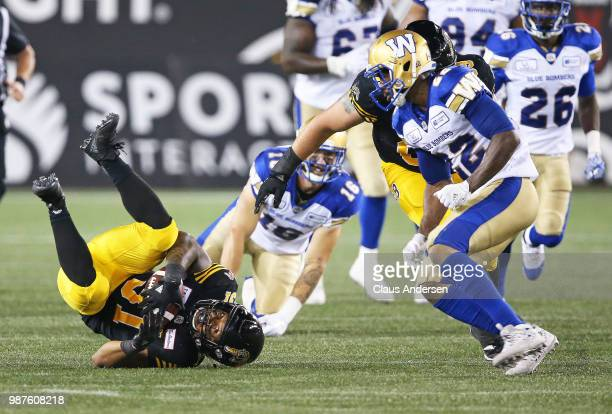 Sean Erlington of the Hamilton TigerCats is taken down against the Winnipeg Blue Bombers in a CFL game at Tim Hortons Field on June 29 2018 in...