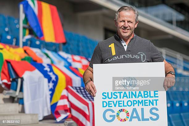 Sean Fitzpatrick Chairman of the Laureus Academy poses with a board reading Sustainable Development Goals during the Laureus Sport For Good Summit on...