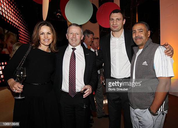 Sean Fitzpatrick , his wife Bronwyn Fitzpatrick, Vitali Klitschko and Daley Thompson attend the Laureus Sport For Good Dinner at Mercedes-Benz...