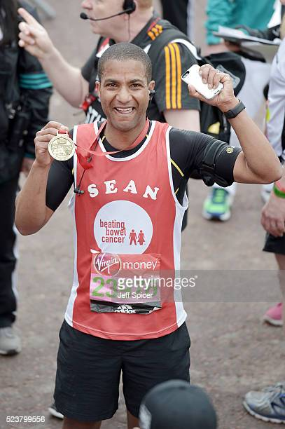 Sean Fletcher poses with his medal after completing the Virgin Money London Marathon on April 24 2016 in London England