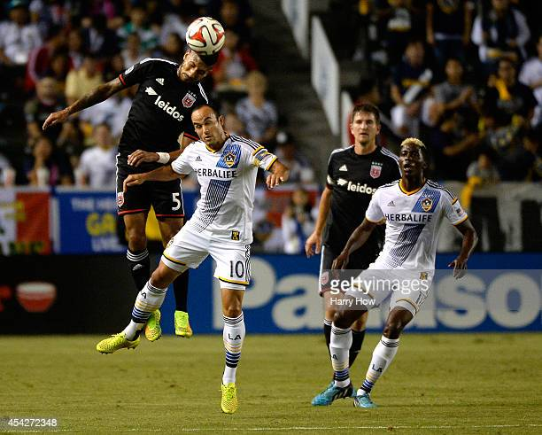 Sean Franklin of DC United heads the ball above Landon Donovan of the Los Angeles Galaxy as Gyasi Zardes looks on during the first half at StubHub...