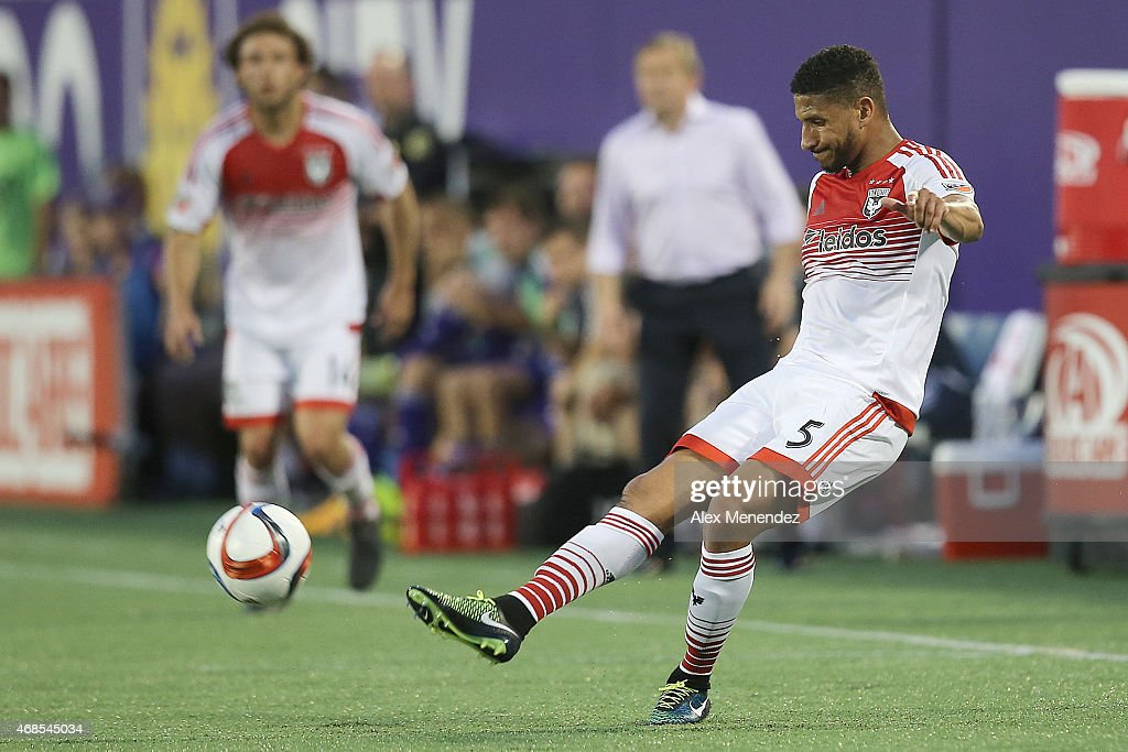 Sean Franklin #5 of D.C. United kicks the ball during a MLS soccer match between DC United and the Orlando City SC at the Orlando Citrus Bowl on April 3, 2015 in Orlando, Florida.