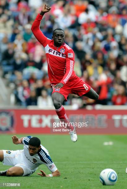 Sean Franklin of the Los Angeles Galaxy and Dominic Oduro of the Chicago Fire go for the ball in an MLS match on April 17 2011 at Toyota Park in...