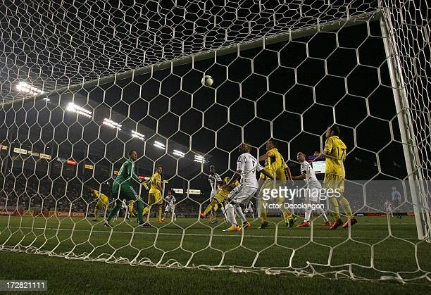 Sean Franklin of the Los Angeles Galaxy and goalkeeper Andy Gruenebaum of the Columbus Crew watch as a shot goes over the net in the second half of...