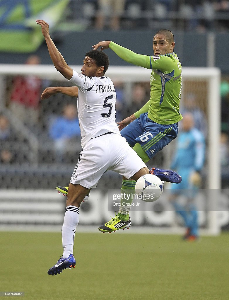 Sean Franklin #5 of the Los Angeles Galaxy battles David Estrada #16 of the Seattle Sounders at CenturyLink Field on May 2, 2012 in Seattle, Washington. The Sounders defeated the Galaxy 2-0.