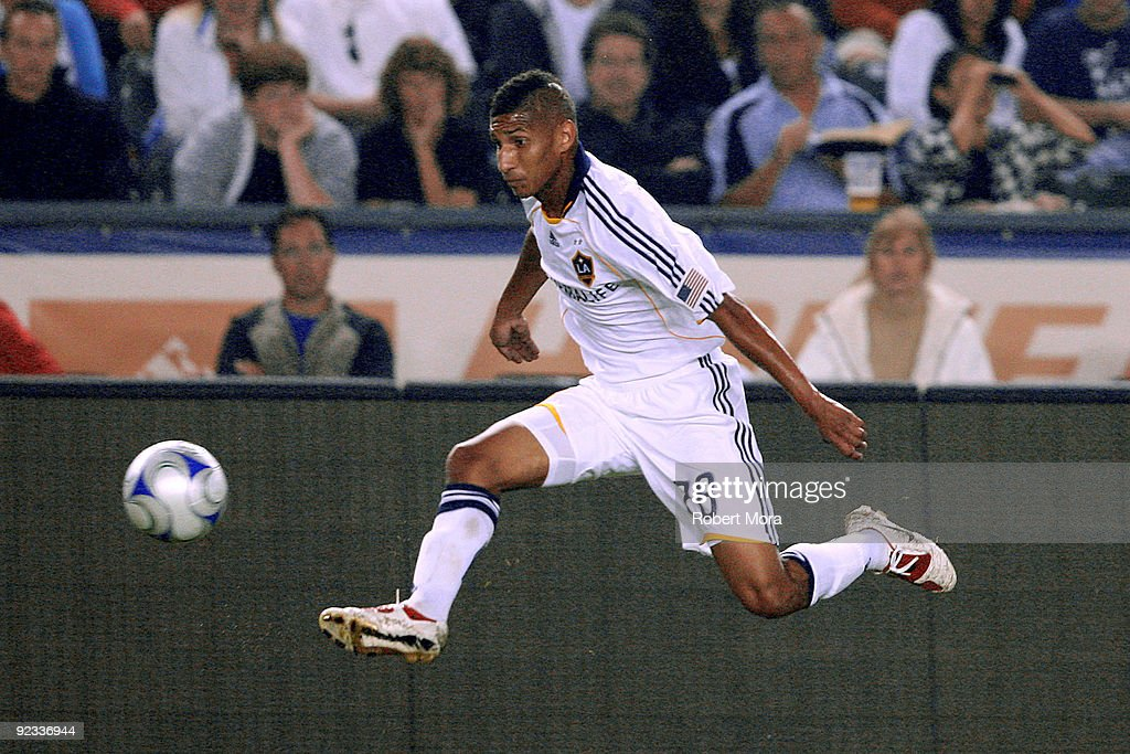 Sean Franklin #28 of the Los Angeles Galaxy stops a ball in mid air against the defense of the San Jose Earthquakes during their MLS game at The Home Depot Center on October 24, 2009 in Carson, California.