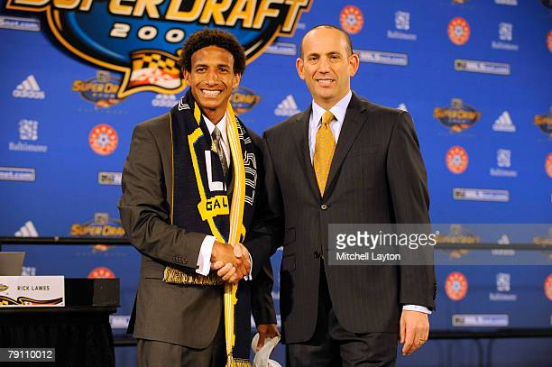 Sean Franklin poses with Don Garber MLS Commissioner after being selected fourth by Los Angeles Galaxy in the MLS Super Draft on January 18 2008 at...