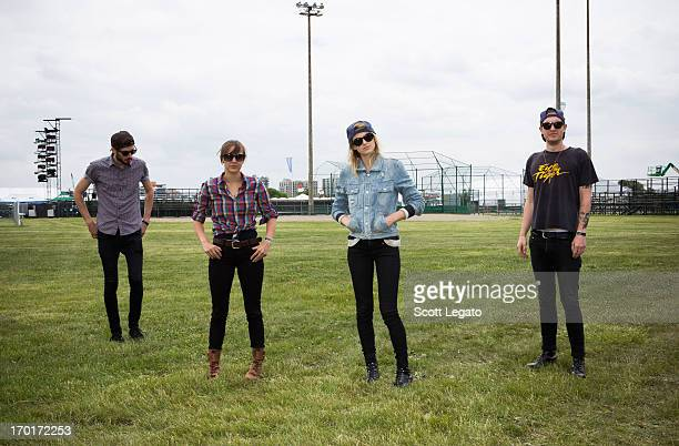 Sean Friday Siouxsie Medley Emily Armstrong and Chris Null of Dead Sara pose backstage during the 2013 Orion Music More Festival at Belle Isle Park...
